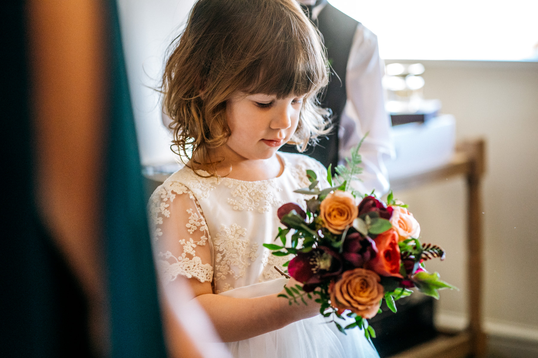 flower girl with orange bouquet