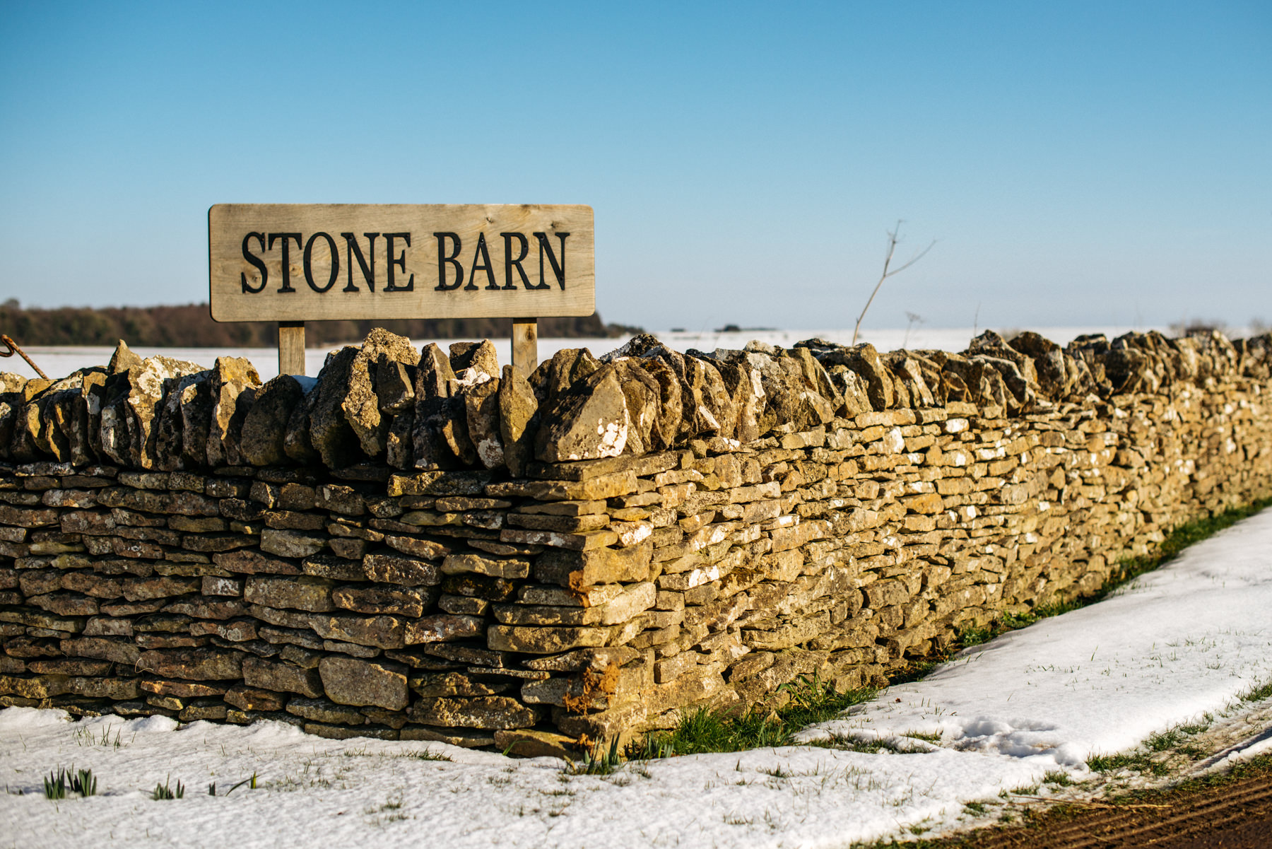 Stone Barn Cotswolds in snow