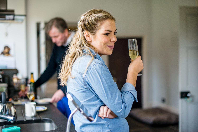 bridesmaid drinking champagne