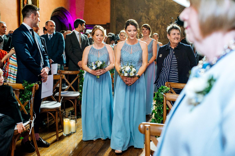 bridesmaids walking down aisle in Buck Hall
