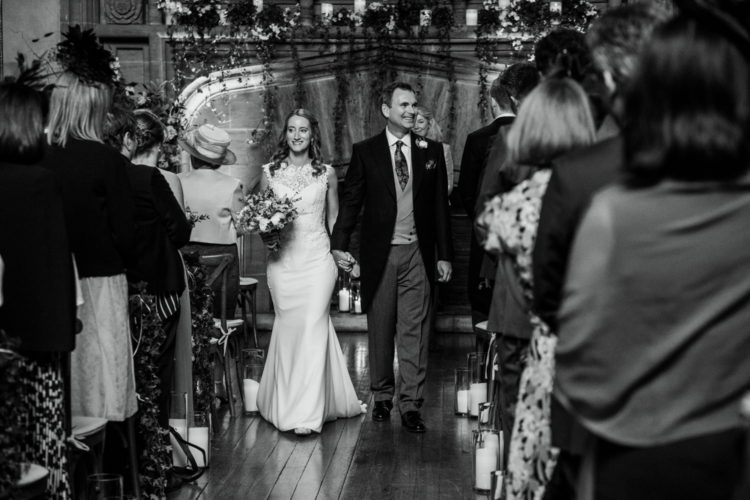 married couple walking down the aisle