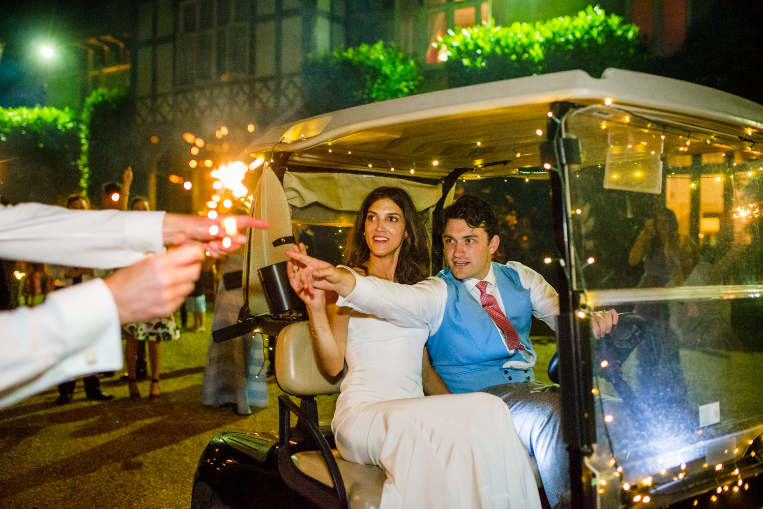 bride and groom leaving on a gold buggy