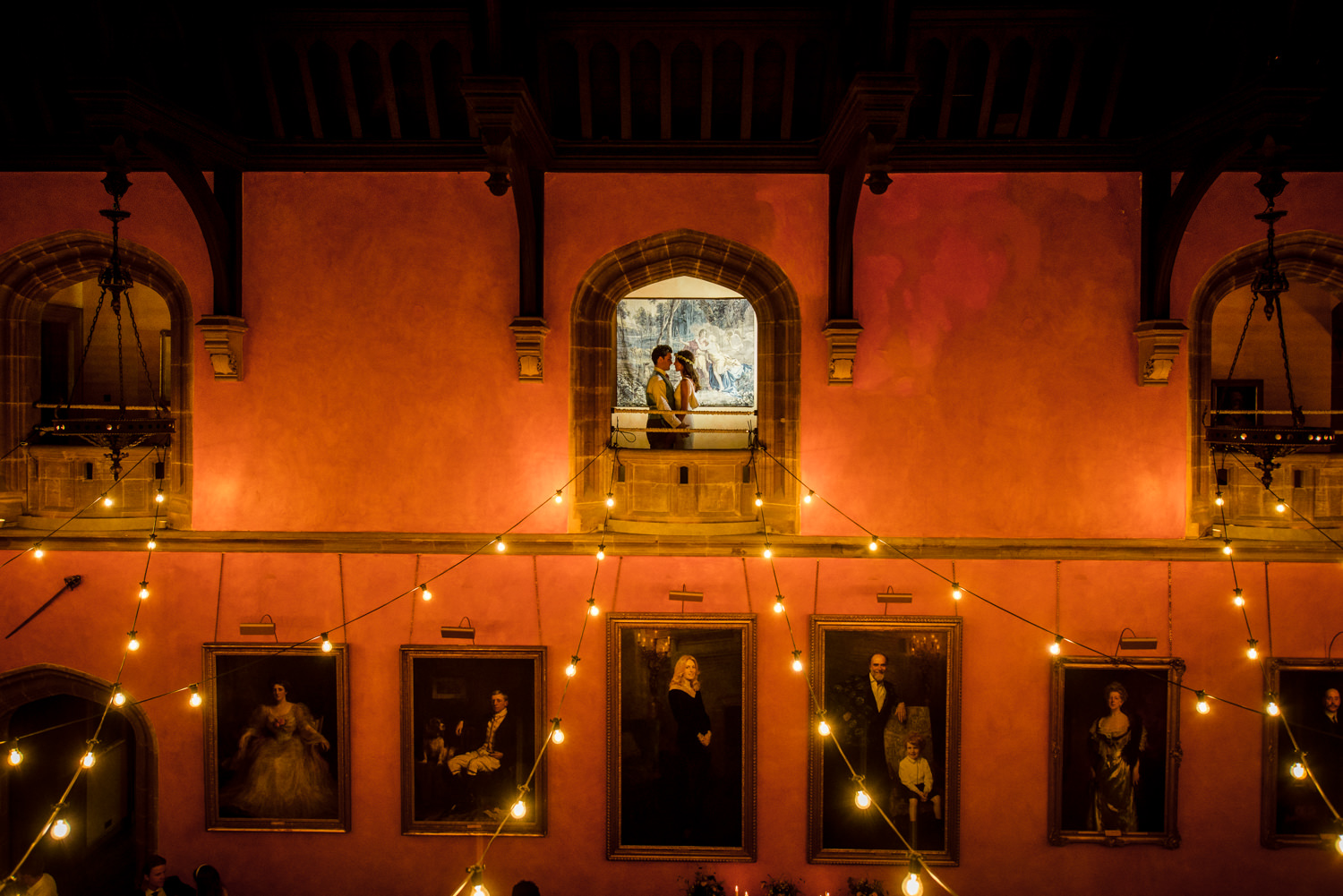 Bride and groom portrait in Buck Hall at Cowdray House