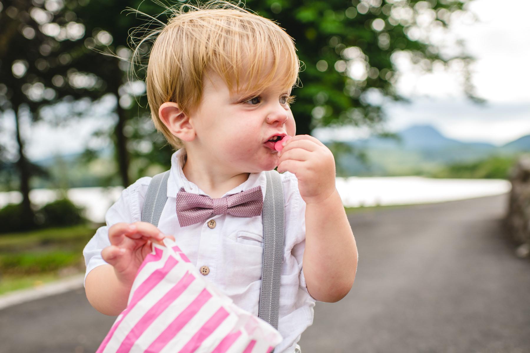 kid eating sweets at wedding