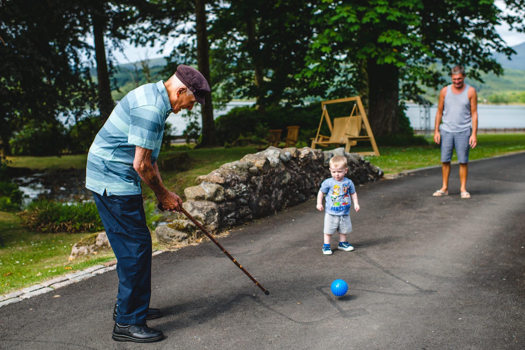 grandad playing golf with walking stick